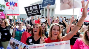 Pro-life supporters with Concerned Women for America celebrate the Hobby Lobby victory at the Supreme Court on June 30. (Reuters/Jonathan Ernst)