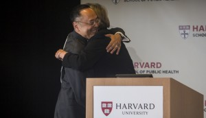 ZORIGOO TUGSBAYAR (photo credit) Gerald L. Chan, left, and University President Drew G. Faust embrace upon receiving the $350 million gift.
