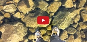 walking across a crystal clear frozen lake