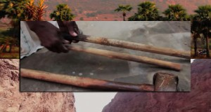 man uses hammer and chisel to remove mountain