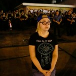 girl stands in front of st louis police
